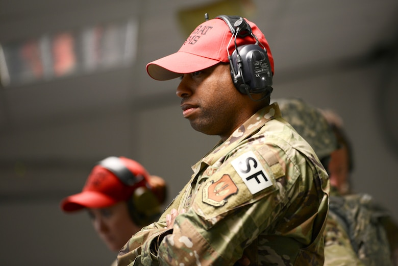 Tech. Sgt. Terence Mimms, NCOIC of Combat Arms from the 31st Security Forces Squadron at Aviano Air Base, Italy, watches students in the Air Force Qualification Course at Aviano's indoor firing range, June 20, 2019. Mimms said he feels ecstatic about the range reopening. (U.S. Air Force photo by Airman 1st Class Ericka A. Woolever).