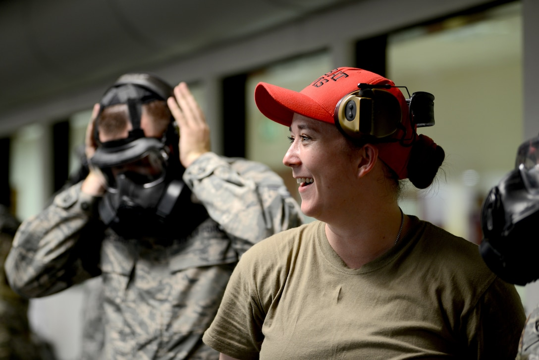 Staff Sgt. Brandee Hahn, combat arms instructor from the 31st Security Forces Squadron, at Aviano Air Base, Italy, teaches an Air Force Qualification Course at Aviano's indoor firing range, June 20, 2019. There were 12 members in the class. (U.S. Air Force photo by Airman 1st Class Ericka A. Woolever).
