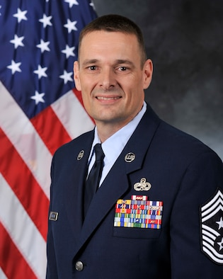 U.S. Air Force Chief Master Sgt. Greg Peterson, 633rd Air Base Wing command chief, effective June, 2019.