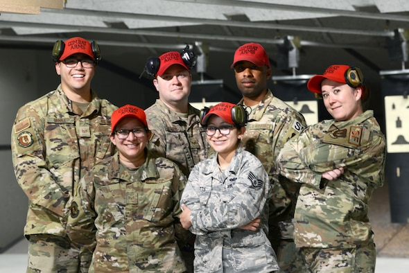 Members of 31st SFS Combat Arms pose for a group photo at Aviano's indoor firing range at Aviano Air Base, Italy, June 20, 2019. Staff Sgt. Brandee Hahn, combat arms instructor from the 31st Security Forces Squadron said the team put in a lot of work to get the range reopened. (U.S. Air Force photo by Airman 1st Class Ericka A. Woolever).
