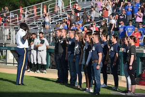 Capt. Daniel Geu, of the Fargo Military Entrance Processing Station (MEPS), far left, administers the oath of enlistment to recent enlistees in various branches of the U.S. Military, including several North Dakota Air National Guard student flight members, during a commitment ceremony at the Military Appreciation Night for the Fargo-Moorhead RedHawks baseball game, Newman Outdoor Field, Fargo, N.D., June 18, 2019.