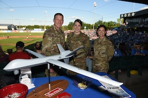 Members of 119th Wing recruiting and retention office from left to right Tech. Sgt. Neil Nelson, Tech. Sgt. Shelly Fink and Senior Master Sgt. Merri Jo 'MJ' Filloon prepare to visit with people attending the Military Appreciation Night for the Fargo-Moorhead RedHawks baseball game, Newman Outdoor Field, Fargo, N.D., June 18, 2019.