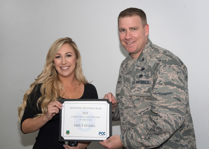 Senior leaders present award to FCC provider of the year