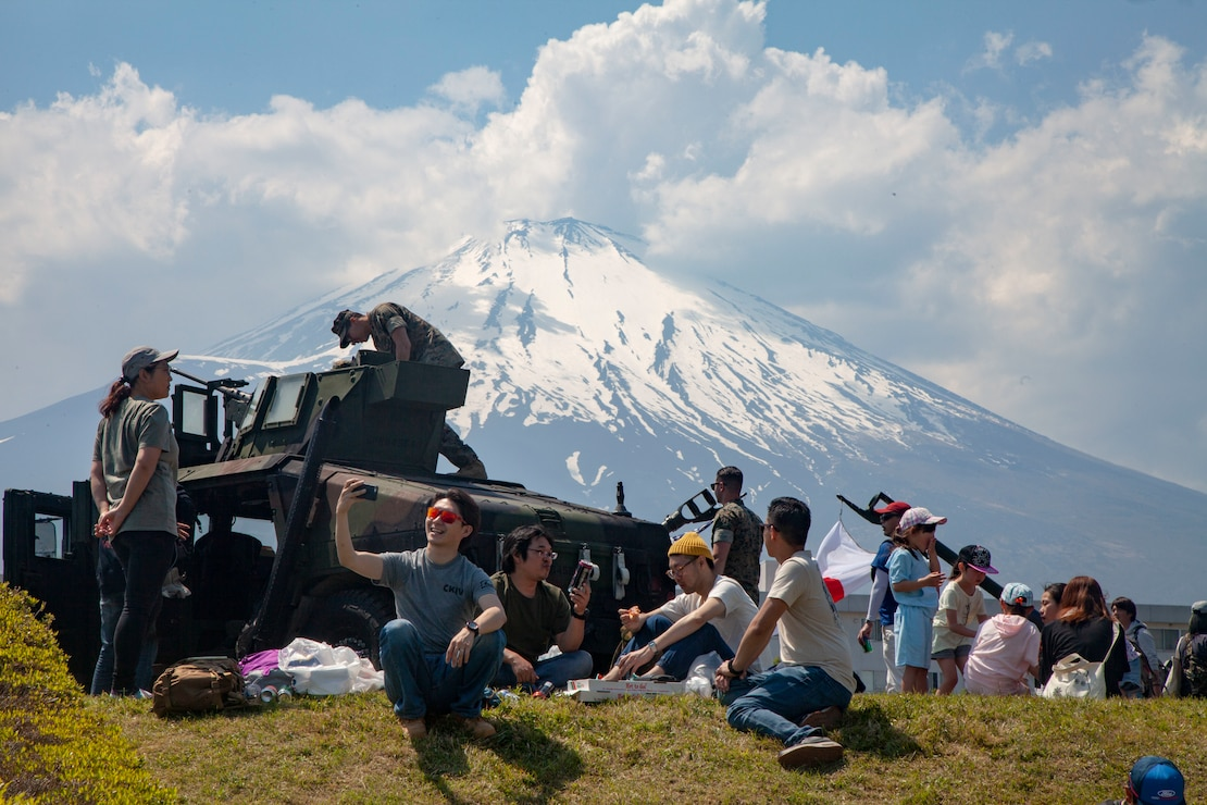 Festival attendees relax during the Friendship Festival May 11, 2019, on Combined Arms Training Center Camp Fuji, Shizuoka, Japan. The festival is one of the largest community relations events the Marine Corps hosts in Japan.