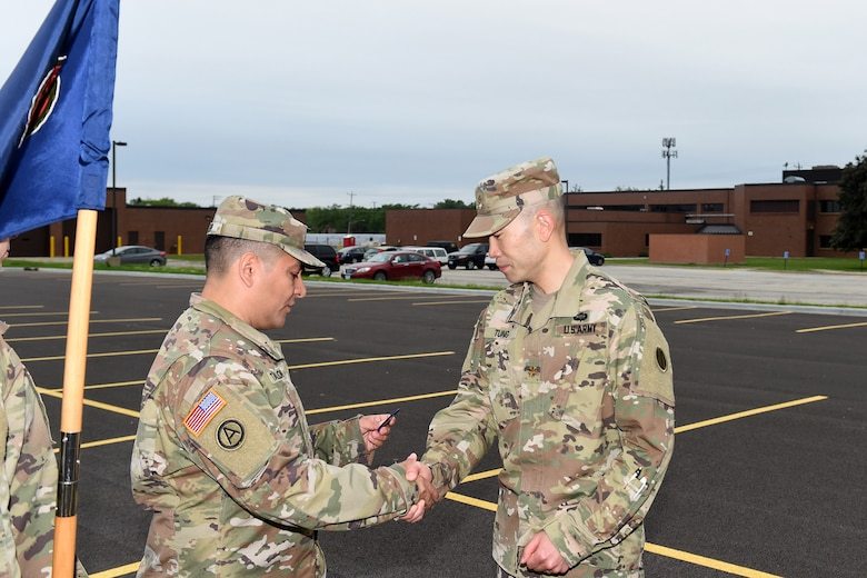 Maj. Christopher Tung, right, receives the Army Fitness Badge during the 85th U.S. Army Reserve Support Command headquarters weekend battle assembly, June 8, 2019.