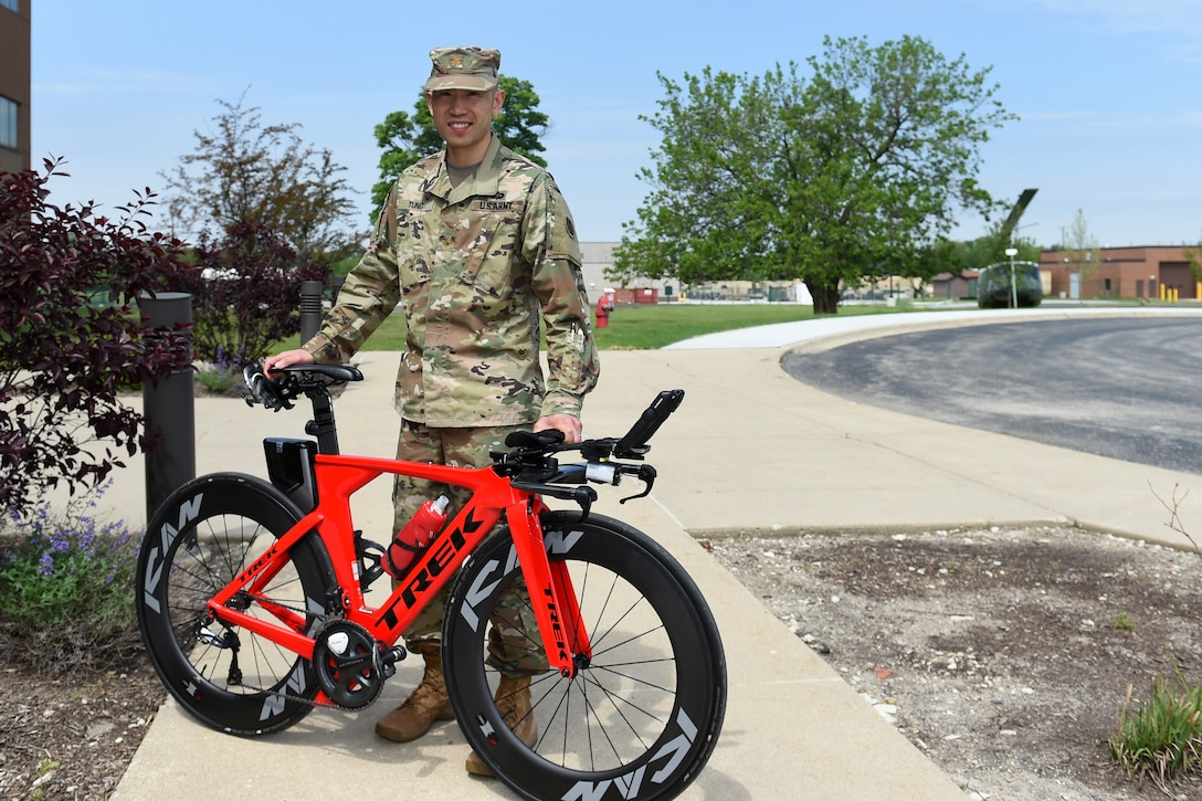 Maj. Christopher Tung pauses for a photo with his speed bicycle. Tung said the geometry and aerodynamics of the bike make it 'really fast'.