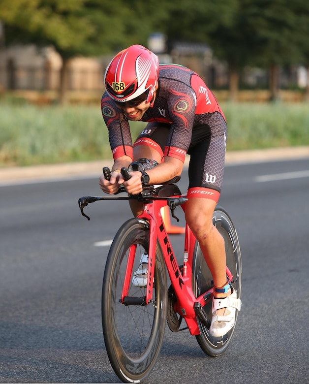 Maj. Christopher Tung rides his speed bicycle. Tung said the geometry and aerodynamics of the bike make it 'really fast'.