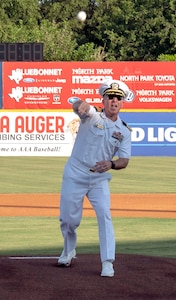 Capt. Tim Richardson, Navy Medicine Education, Training and Logistics Command deputy commander, throws out the traditional first pitch at a San Antonio Missions minor-league baseball game as part of Military Appreciation Night pre-game activities June 12.