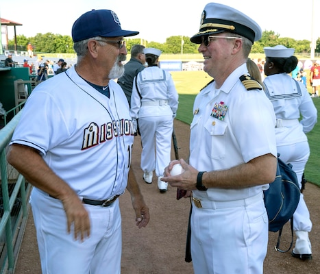 Capt. Timothy Richardson (right), deputy commander of Navy Medicine Education, Training and Logistics Command, or NMETLC, talks with Rick Sweet, manager of the San Antonio Missions baseball team, after throwing out the first pitch at the Missions baseball game in honor of military appreciation night June 12.