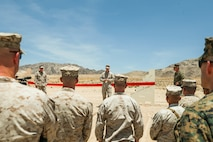 U.S. Marine Corps Col. Kyle B. Ellison, commanding officer, 7th Marine Regiment, 1st Marine Division, I Marine Expeditionary Force, makes comments at the ribbon cutting ceremony for the re-opening of Range 105A at Marine Corps Air Ground Combat Center, Twentynine Palms, Calif., Jun 17, 2019. The range was re-designed to offer multiple,  efficient types of training to individual Marines and squad-sized elements. (U.S. Marine Corps photo by Pfc. Gustavo Romero)