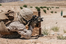 U.S. Marine Corps Sgt. Adam N. Shane, rifleman, 3rd Battalion, 4th Marine Regiment, 1st Marine Division, shoots at targets following the re-opening ceremony of Range 105A at Marine Corps Air Ground Combat Center, Twentynine Palms, Calif., Jun 17, 2019. The range was re-designed to offer multiple, efficient types of training to individual Marines and squad-sized elements. (U.S. Marine Corps photo by Pfc. Gustavo Romero)