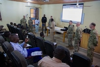 Chief Warrent Officer 2 Tracy Batten, a supervisory equipment specialist, gives a class over Excel and data analysis during the site visit component of Operation Hydrocarbon June 12, 2019 at Camp Badage, Niger. The operation was a five-day exercise with a goal of exchanging tactic, procedures, and techniques for fuel, logistical, and maintenance operations.