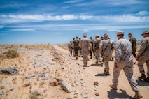U.S. Marines tour Range 105A following the ribbon cutting ceremony for the re-opening of the range at Marine Corps Air Ground Combat Center, Twentynine Palms, Calif., June 17, 2019. The range was re-designed to offer multiple, efficient types of training to individual Marines and squad-sized elements. (U.S. Marine Corps photo by Cpl. Rachel K. Young-Porter)