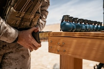A U.S. Marine loads 5.56 mm ammunition into a magazine in preparation for a live-fire exercise following the re-opening of Range 105A at Marine Corps Air Ground Combat Center, Twentynine Palms, Calif., June 17, 2019. The range was re-designed to offer multiple, efficient types of training to individual Marines and squad-sized elements. (U.S. Marine Corps photo by Cpl. Rachel K. Young-Porter)