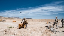 U.S. Marine Corps Sgt. Tyler Thomas (far left), squad leader, 2nd Battalion, 7th Marine Regiment, 1st Marine Division, throws a training grenade following the re-opening of Range 105A at Marine Corps Air Ground Combat Center, Twentynine Palms, Calif., June 17, 2019. The range was re-designed to offer multiple, efficient types of training to individual Marines and squad-sized elements. (U.S. Marine Corps photo by Cpl. Rachel K. Young-Porter)