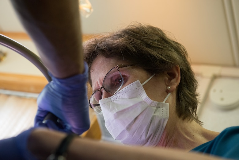 U.S. Air Force Lt. Col. Julie Robinson, the dental officer-in-charge for Delta Area Economic Opportunity Corporation Tri-State Innovative Readiness Training 2019 and a dentist with the 176th Wing, Alaska Air National Guard, performs a tooth extraction procedure at a temporary clinic in Sikeston, Mo., June 19, 2019. U.S. service members deployed to Sikeston as part of a joint service medical exercise that provides training to service members and no-cost medical services to the community. (U.S. Air National Guard photo by Senior Airman Jonathan W. Padish)