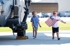 Children tour an HH-60G Pave Hawk helicopter