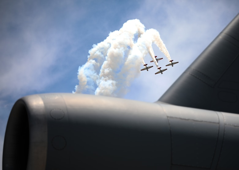 The Aeroshell AT-6 Texan Aerobatic Team performs during the Wings over Whiteman Air and Space Show