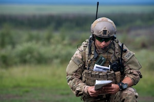 A Joint Terminal Attack Controller takes notes during close air support training