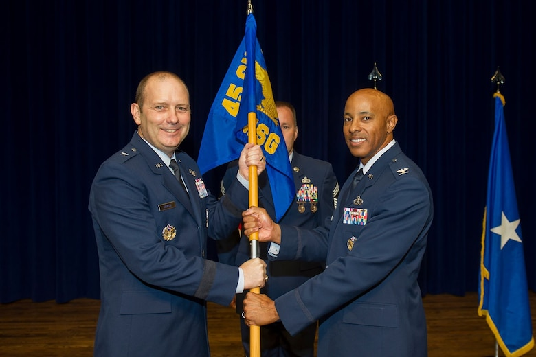 Brig. Gen. Douglas Schiess, 45th Space Wing commander, receives the 45th Mission Support Group guidon from Col. Kevin Williams, the outgoing 45th MSG commander, on June 17, 2019, at Patrick Air Force Base, Fla. (U.S. Air Force photo by Jared Trimarchi)