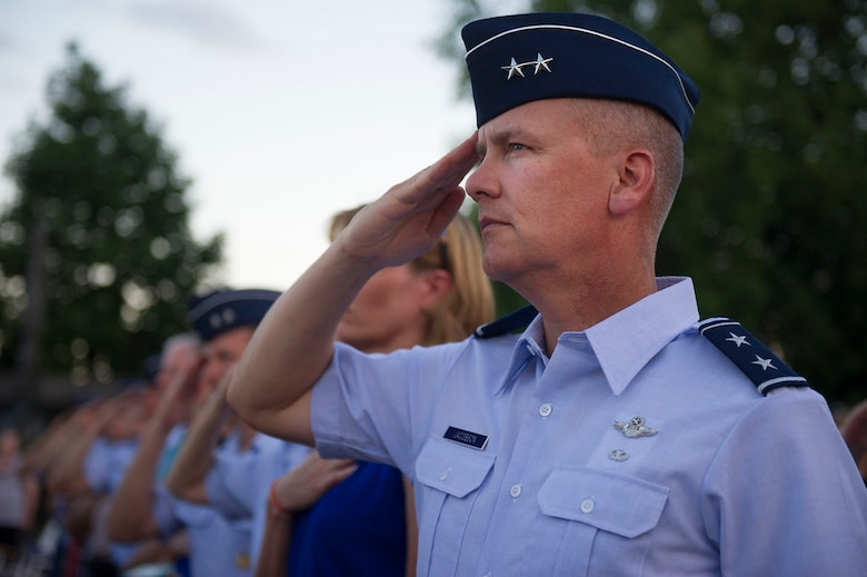 Air Force District of Washington Commander Maj. Gen. James A. Jacobson renders honors during the playing of the national anthem at the Air Force Memorial in Arlington Va., July 7, 2017 at the start of  the Heritage to Horizons concert series. U.S. Air Force Vice Chief of Staff Gen. Stephen W. Wilson hosted the event, which was the third concert of the series. The Heritage to Horizons concerts are a recurring public ceremonial event that takes place at the Air Force Memorial and honor those who support the Air Force. The theme of the third concert was Airmen who Broke Barriers. (U.S. Air Force Photo by Senior Master Sgt. Adrian Cadiz)(Released)