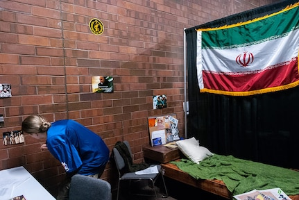 SGT Jordan Lisandrelli from the 341st Military Intelligence Battalion, Washington Army National Guard, sorts through personal items of a fictional target to create a mock profile during the Site Exploration event of the 2019 Polyglot Games at the brigade's 30th Annual Language Conference, March 2019