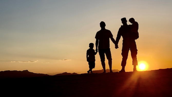 (From right to left) Tech. Sgt. Joshua Chevalier, 49th Maintenance Group weapons contracting officer's representative, poses for a photo with his husband, Ryan Chevalier, and their two children, June 11, 2019, at White Sands National Monument, N.M. The Chevaliers reflected on how the acceptance of lesbian, gay, bisexual and transgender has changed for the better over Joshua's time in service. (U.S. Air Force photo by 2nd Lt. Joshua Thompson)