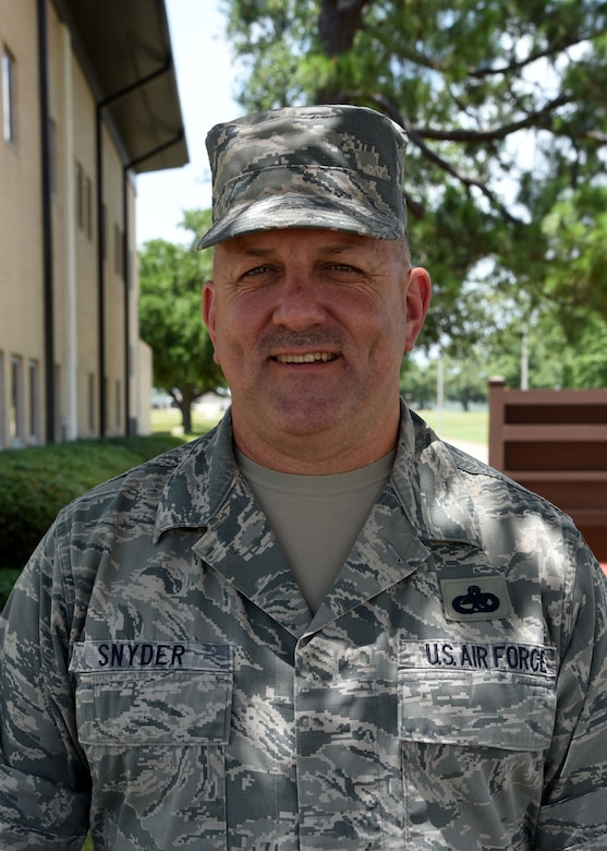 Chief Master Sgt. Monte Snyder in one of three master resiliency trainers for the 403rd Wing, Keesler Air Force Base, Mississippi. He assists with teaching first term Airmen in nine areas that enhance resilience, one of the core tenets of the Air Force's Comprehensive Airman Fitness, which encompasses creating Airmen with solid mental, physical, social and spiritual well-being. (U.S. Air Force photo/Lt. Col. Marnee A.C. Losurdo)
