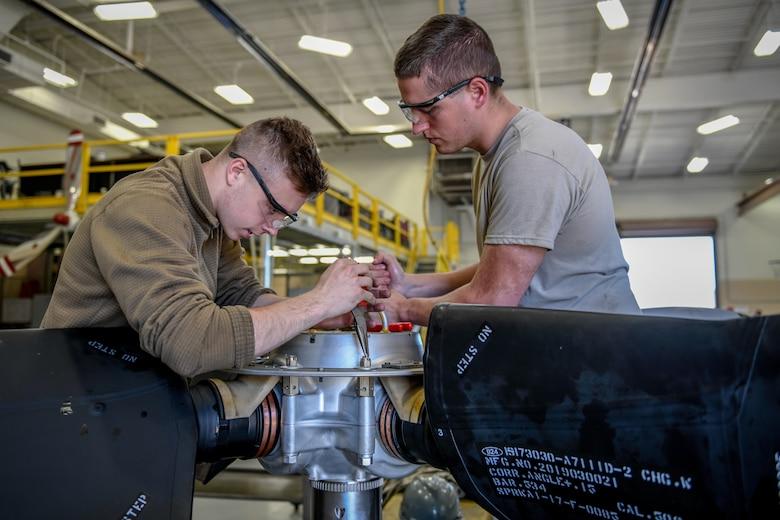 Senior Airman Sean Kenney, an aerospace propulsion apprentice with the 910th Aircraft Maintenance Squadron, and Senior Airman Daniel Phillis, an aerospace propulsion journeyman with the 910 AMXS, repair a propeller June 11, 2019, here.