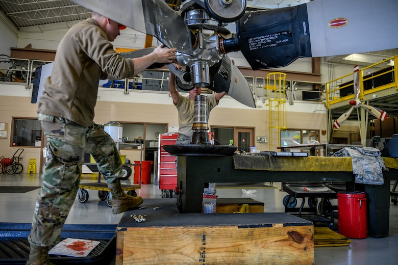 Senior Airman Sean Kenney, an aerospace propulsion apprentice with the 910th Aircraft Maintenance Squadron, and Tech. Sgt. Steven Lew, an aerospace propulsion craftsman with the 910 AMXS, prepare a propeller for installation on a C-130H Hercules aircraft June 11, 2019, here.
