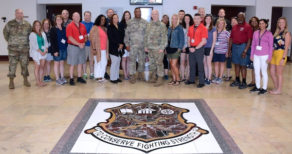 "Maj. Tom Roader, Cleveland Recruiting Battalion (far left) pictured with a group of educators from the Ohio area.  Maj. Gen. Patrick D. Sargent, U.S. Army Medical Department Center and School, Health Readiness Center of Excellence commanding general (center left), and HRCoE Command Sgt. Maj. William ""Buck"" O'Neal (center right), the AMEDDC&S HRCoE command sergeant major hosted the educator tour to Joint Base San Antonio-Fort Sam Houston June 11 in support of the U.S. Army Recruiting Command's mission."