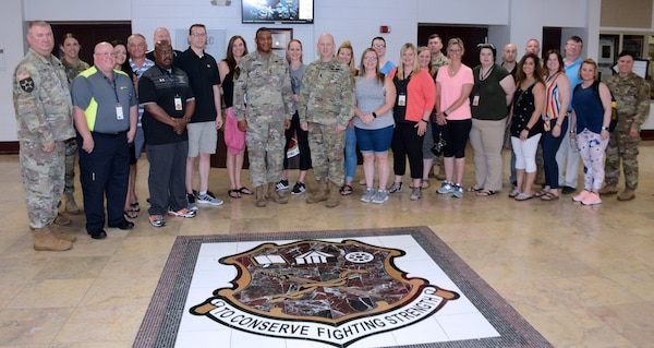 "Maj. Joseph Miller, Milwaukee Recruiting Battalion (far left) is pictured with other recruiting soldiers and officers and a group of educators from the Wisconsin and Northern Illinois area. Maj. Gen. Patrick D. Sargent (center left) and Command Sgt. Maj. William ""Buck"" O'Neal (center right), the U.S. Army Medical Department Center and School, Health Readiness Center of Excellence commanding general and command sergeant major, respectively, hosted the educator tour to Joint Base San Antonio-Fort Sam Houston June 11."