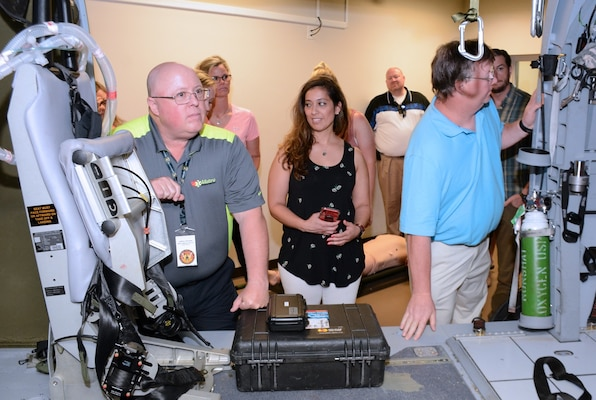 A group of educators from the Wisconsin and Northern Illinois area tour the flight paramedic simulator at Joint Base San Antonio-Fort Sam Houston during an educator's tour hosted by the U.S. Army Medical Department Center & School, Health Readiness Center of Excellence June 11.
