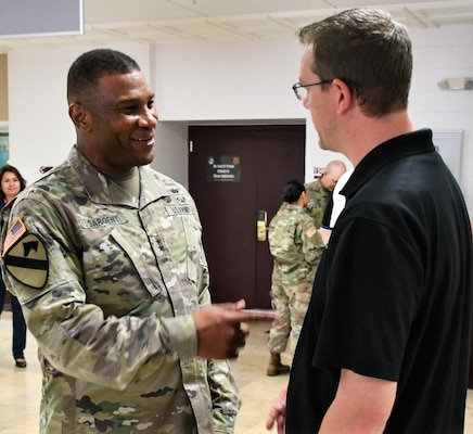 Maj. Gen. Patrick D. Sargent (left), commander U.S. Army Medical Department Center & School, Health Readiness Center of Excellence, engages with a group of more than 70 high school administrators, teachers and college professors visiting from across Wisconsin, Northern Illinois and Ohio sponsored by the Cleveland and Milwaukee U.S. Army Recruiting Battalions.