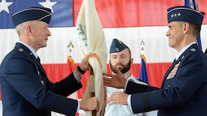 U.S. Air Force Lt. Gen. Marc Sasseville, commander, 1 AF (Air Forces Northern) and Continental U.S. North American Aerospace Defense Command Region (CONR) accepts the CONR (AFNORTH) guidon from General Terrance O'Shaughnessy, commander, United States Northern Command and North American Aerospace Defense Command, during a change of command ceremony June 20, 2019, Tyndall AFB, Fla.  O'Shaughnessy, along with General James Holmes, commander, Air Combat Command, officiated the 1 AF, CONR (AFNORTH) Change of Command.