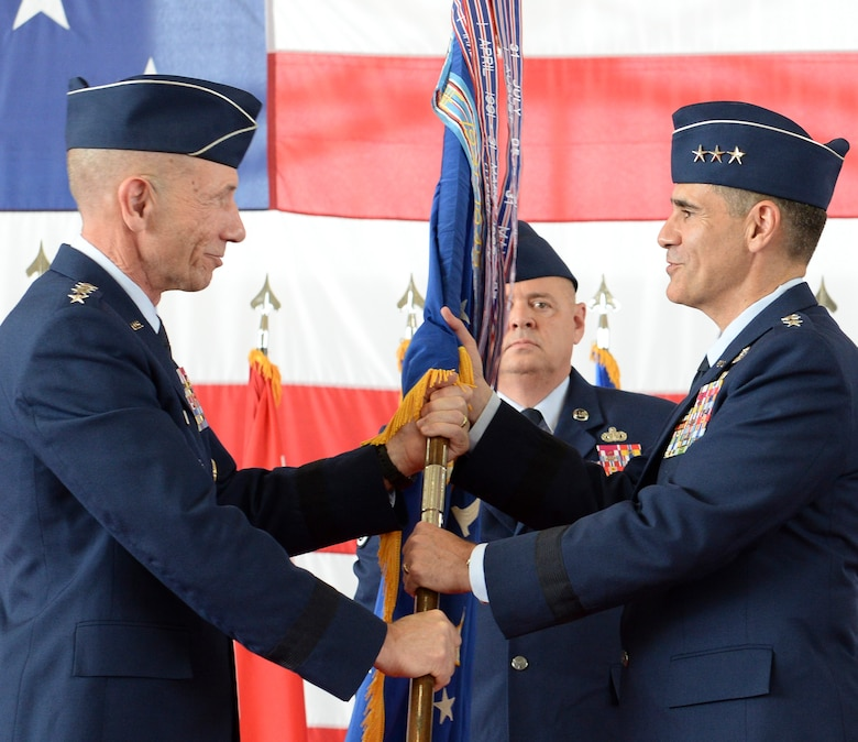 U.S. Air Force Lt. Gen. Marc Sasseville, commander, 1 AF (Air Forces Northern) and Continental U.S. North American Aerospace Defense Command Region (CONR) accepts the 1 AF guidon from General James Holmes, commander, Air Combat Command, during a change of command ceremony June 20, 2019, Tyndall AFB, Fla.  Holmes, along with General Terrance O'Shaughnessy, commander, United States Northern Command and North American Aerospace Defense Command officiated the 1 AF, CONR (AFNORTH) Change of Command. (U.S. Air National Guard Photo by Master Sgt. Regina Young)