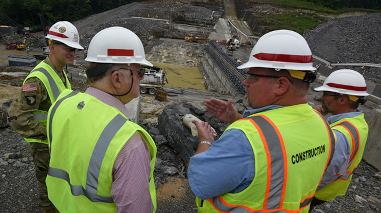 Bill DeBruyn (Second from right), Center Hill Dam Rehabilitation Project resident engineer, explains the status of ongoing construction of a roller compacted concrete berm next to the saddle dam to William S. Crowder (Second from left), Army Science Board study chair, during a visit June 18, 2019 to the project in Silver Point, Tenn.  Lt. Col. Cullen Jones, U.S. Army Corps of Engineers Nashville District commander, and Ben Rohrbach, Nashville District Engineering and Construction Division chief, also provided project input. (USACE photo by Lee Roberts)