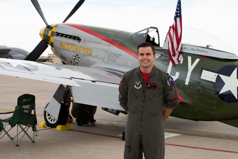 1st Lt. Jordan Tencati, a T-38 instructor pilot assigned to the 13th Bomb Squadron, poses for a portrait on June 16, 2019, at Whiteman Air Force Base, Missouri. Tencati visited the various historic aircraft, including the P-51 Mustang,on display at the 2019 Wings Over Whiteman Air and Space Show. (U.S. Air Force photo by Staff Sgt. Kayla White)