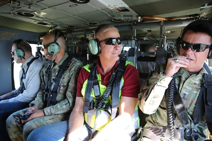 Major General Jeff Burton, the adjutant general; Allan Matheson, executive director of the Department of Environmental Quality; Joshua Emfield, deputy director for Congressman Curtis; Larry Ellertson, advisor to Congressman Curtis; Don Summit, engineer with Construction Facilities Management Office and other members of the Utah National Guard flew on a UH-60 Black Hawk to view the burn scar left from the Coal Hollow Fire on Loafer Mountain located at the south end of Utah County, June 19, 2019.