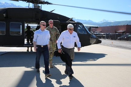 Larry Ellertson, advisor to Congressman Curtis; Joshua Emfield, deputy director for Congressman Curtis; Brig. Gen. Dar Craig, Director of Joint Staff, Utah National Guard exit the UH-60 Black Hawk after viewing the burn scar left from the Coal Hollow Fire on Loafer Mountain located at the south end of Utah County, June 19, 2019.