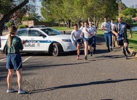 U.S. Air Force 60th Security Forces Squadron defenders complete their portion of the Northern California Law Enforcement Torch Run June 20, 2019, at Travis Air Force Base, California. Hundreds of Law Enforcement personnel from northern California escorted the Special Olympics torch, the Flame of Hope, throughout their local communities in a relay to the 2019 Special Olympics Northern California Summer Games, being held at the University of California Davis campus June 21-23. (U.S. Air Force photo by Heide Couch)