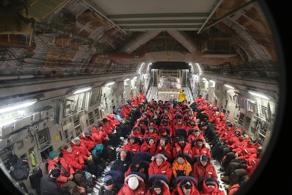 Members assigned to the 304th Expeditionary Airlift Squadron prepare the U.S. Air Force C-17 Globemaster III for the final flight of the 2018-2019 Antarctic research season Christchurch International Airport, Christchurch, New Zealand, Feb. 21, 2019. Maintainers in the orange vests are troubleshooting an issue with the aircraft's avionics system.