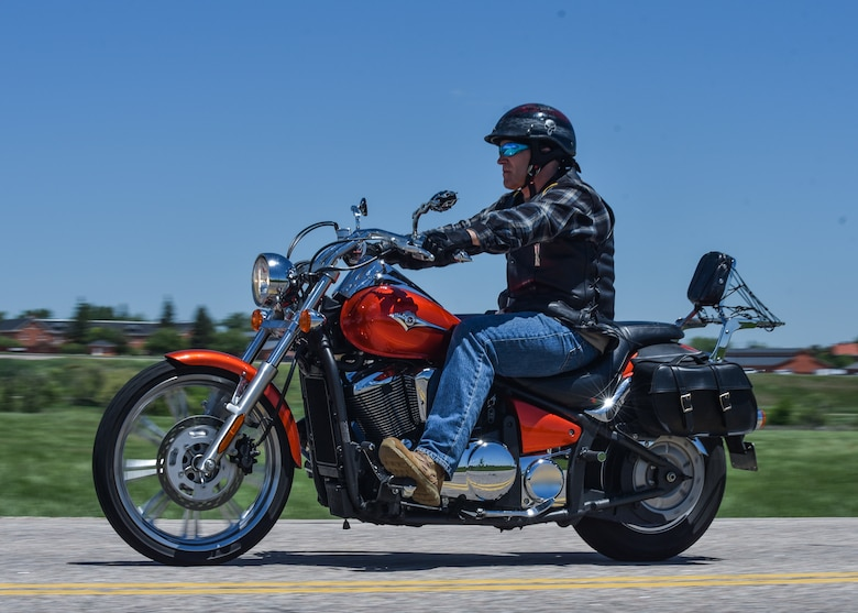 Chief Master Sgt. Beau Jones, 90th Missile Maintenance Squadron maintenance advisor, rides his motorcycle down the road June 20, 2019, on F.E. Warren Air Force Base, Wyo. Due to his vast number of hobbies and talents Jones is commonly called the most interesting Chief at F.E. Warren by his peers. (U.S. Air Force photo by Senior Airman Braydon Williams)