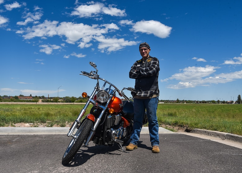Chief Master Sgt. Beau Jones, 90th Missile Maintenance Squadron maintenance advisor, stands with his motorcycle June 20, 2019, on F.E. Warren Air Force Base, Wyo. Jones purchased his motorcycle after he was promoted to Master Sergeant and was looking for a new hobby (U.S. Air Force photo by Senior Airman Braydon Williams)