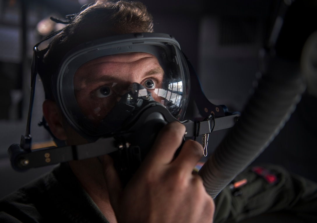 U.S Air Force Senior Airman Jonathan Cummins, 700th Airlift Squadron flight engineer, checks his oxygen levels on a C-130 Hercules before RED-FLAG-Alaska 19-2 near Joint Base Elmendorf-Richardson, Alaska, June 19, 2019. RED-FLAG-Alaska is an annual U.S. Pacific Air Forces field training exercise for U.S. and allied partners to practice combat readiness in a controlled environment. (U.S. Air Force photo by Staff Sgt. Matthew Lotz)