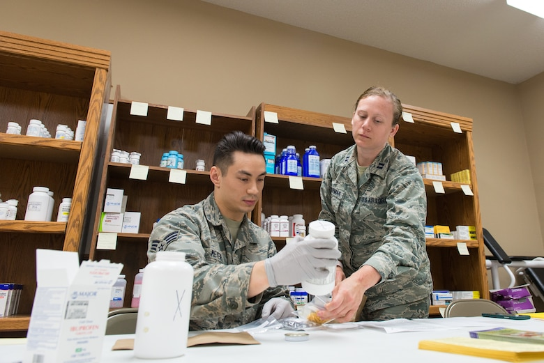 U.S. Air Force Senior Airman Tony Meyer, an aerospace medical technician assigned to the 176th Wing, Alaska Air National Guard, and Capt. Lindsay Chapman, a clinical nurse assigned to the 181st Intelligence Wing, Indiana Air National Guard, measure out medication at the Miner Baptist Church in Sikeston, Missouri, June 14, 2019. Meyer and Chapman deployed to Sikeston in support of Delta Area Economic Opportunity Corporation Tri-State Innovative Readiness Training 2019. (U.S. Air National Guard photo by Senior Airman Jonathan W. Padish)