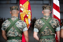 U.S. Marines post colors during a change of command ceremony June 21, 2019 at Marine Corps Air Station Futenma. The change of command ceremony was held in honor of U.S. Marine Corps Lt. Col Brian Ashford relinquishing his duties as commanding officer of Headquarters and Headquarters Squadron, Marine Corps Installations Pacific, to Lt. Col. Eric Starr. (U.S. Marine Corps photo by Lance Cpl. Savannah Mesimer)