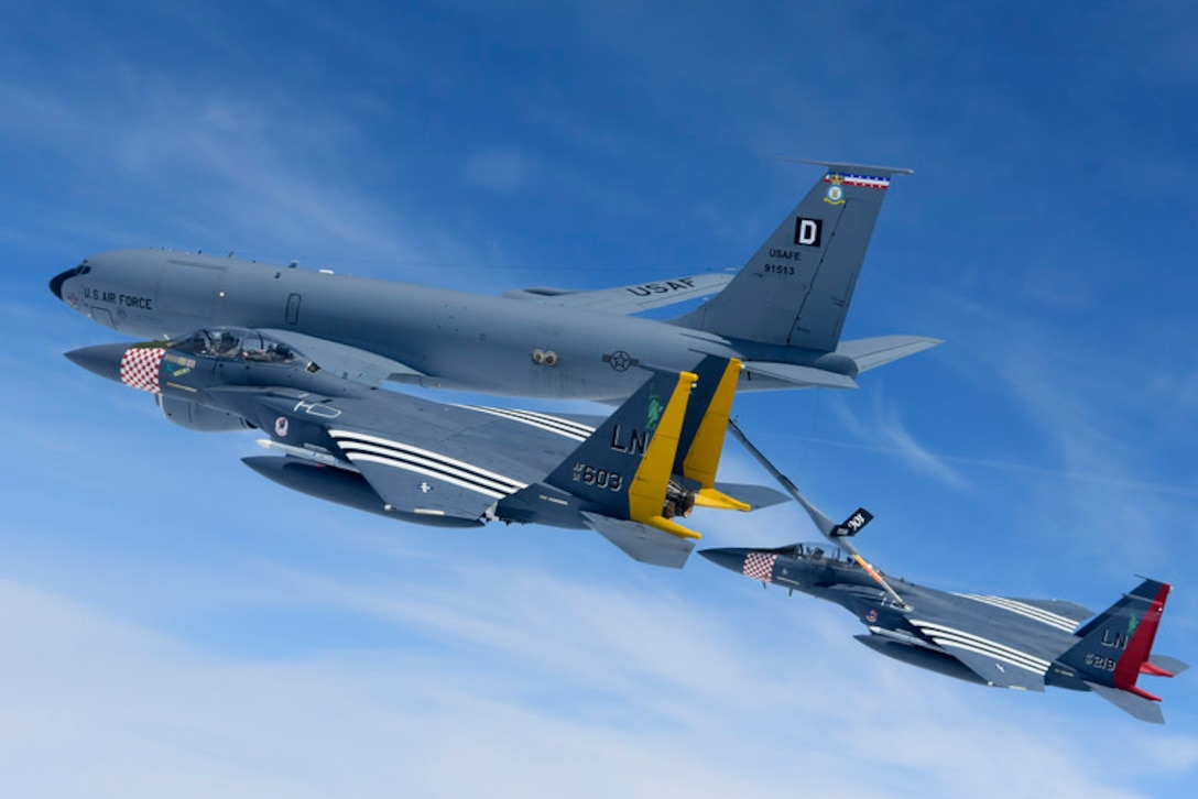 F-15E Strike Eagles assigned to the 48th Fighter Wing conduct in-flight refuelling over the English channel with a KC-135 Stratotanker assigned to the 100th Air Refueling Wing in support of the 75th anniversary of D-Day June 9, 2019. An epic multinational operation, D-Day forged partnerships and reinforces trans-Atlantic bonds that remain to this day. (U.S. Air Force photo/ Tech. Sgt. Matthew Plew)