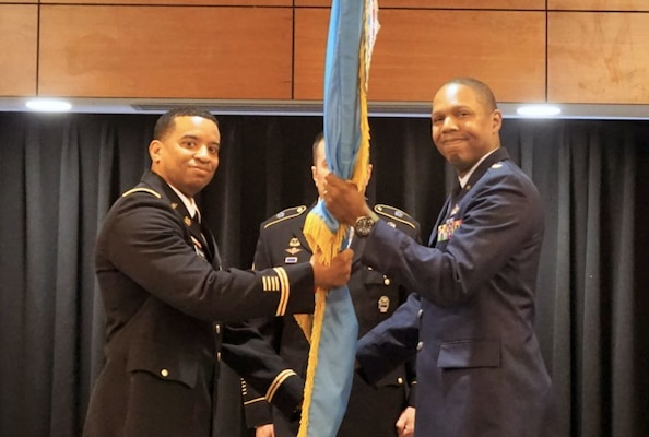 DLA Energy Americas Commander Army Col. Kevin Cotman presented the DLA flag to Air Force Maj. Marcus McWilliams