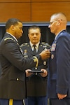 DLA Energy Americas Commander Army Col. Kevin Cotman (left) presented Air Force Lt. Col. Frederick Mueller (right) the Defense Meritorious Service Medal